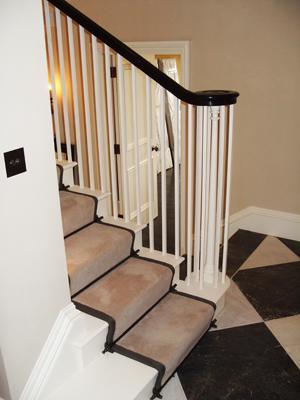 Cut String Stiarcase With Ebonized Handrail