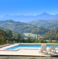 Pyrenees mountain view from gite swimming pool terrace